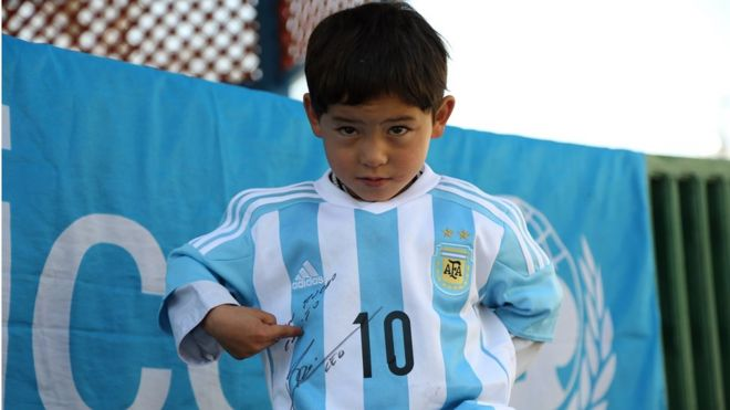 e2c33cd4420 Afghan boy Murtaza Ahmadi posing with a jersey sent to him by Argentine  football star Lionel