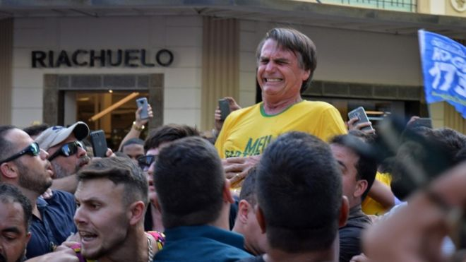 Brazilian right-wing presidential candidate Jair Bolsonaro gestures after being stabbed in the stomach during a campaign rally in Juiz de Fora, Minas Gerais State, in southern Brazil, on September 6, 2018.
