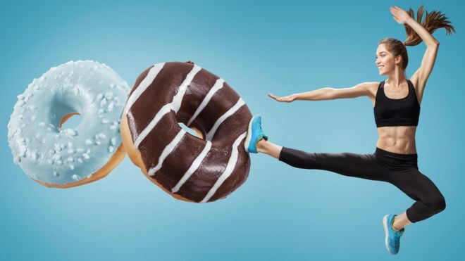 Woman kicking doughnuts