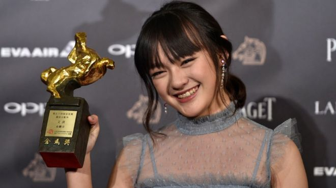 Taiwanese actress Vicky Chen poses after winning the Best Supporting Actress award for the film 'The Bold, the Corrupt, and the Beautiful', at Taiwan's 54th Golden Horse film awards, dubbed the Chinese 'Oscars', in Taipei on 25 November, 2017