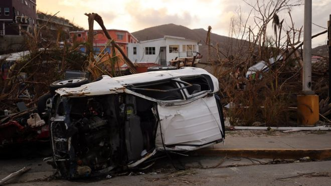 Debris and an overturned car on British Virgin islands