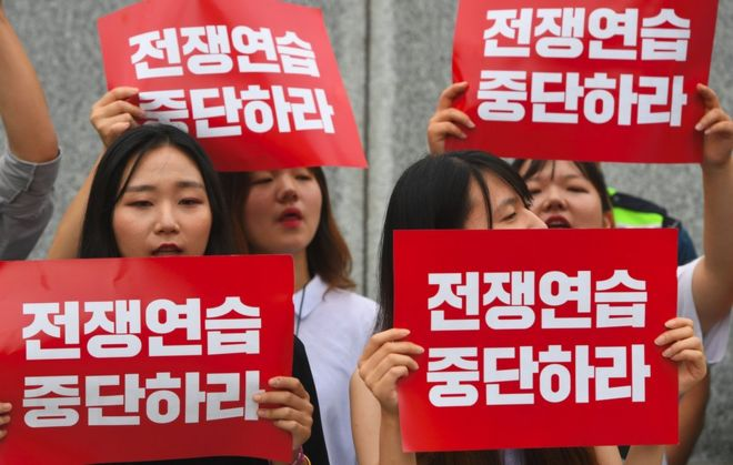 "South Korean protestors hold placards that read ""stop war exercise"" during a rally denouncing the annual Ulchi Freedom Guardian (UFG) joint South Korea-US military exercise, near the US embassy in Seoul on 21 August 2017"