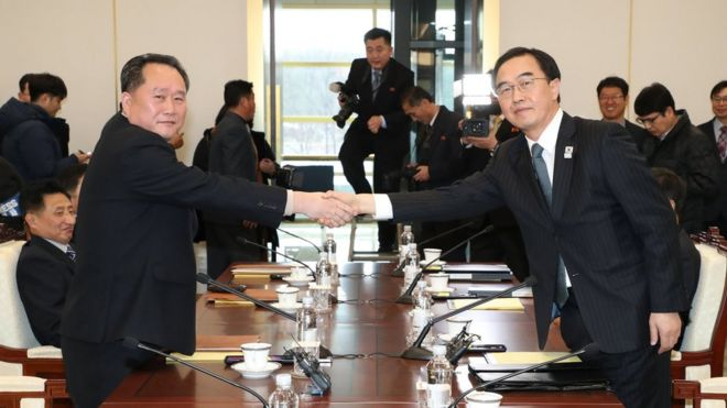 South Korean Unification Minister and chief delegate Cho Myoung-gyon (R) shakes hands with his North Korean counterpart Ri Son-gwon