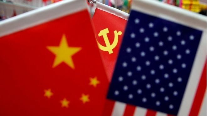 Chinese and US national flags and Chinese Communist Party flag