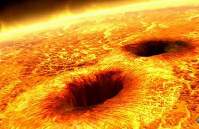 (ภาพจากฝีมือศิลปิน) จุดมืดบนดวงอาทิตย์เกิดจากสนามแม่เหล็กความเข้มสูงที่กักความร้อนเอาไว้ไม่ให้ออกสู่พื้นผิว