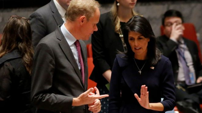 Nikki Haley (R) speaks with Britain's Ambassador to the United Nations Matthew Rycroft before a UN Security Council emergency meeting over North Korea's latest missile launch, 4 September, at UN Headquarters in New York
