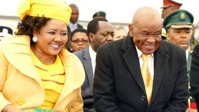 "Newly appointed Lesotho prime Minister Thomas Thabane (C), leader of the All Basotho Convention (ABC) political party, his wife ""Ma Isaiah Ramoholi Thabane (L) and Lesotho King Letsie III (R) react during Thabane""s inauguration on June 16, 2017 in Maseru"