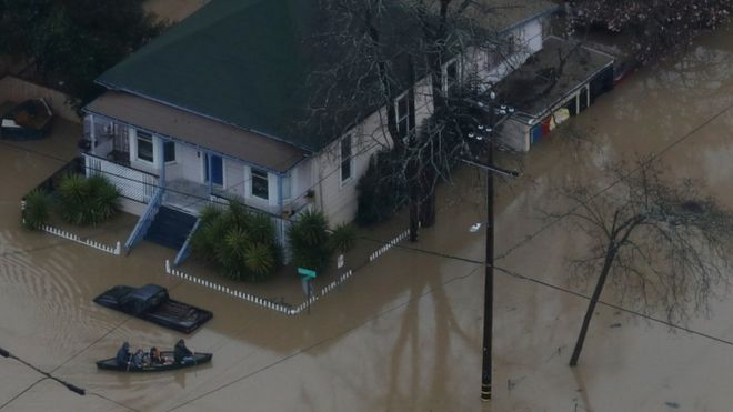 Guerneville residents are forced to travel by canoe through their neighbourhood