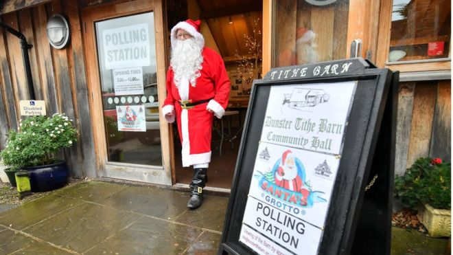Man dressed as Father Christmas at polling station in Somerset