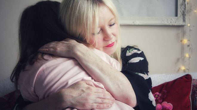 Tracy hugs her daughter