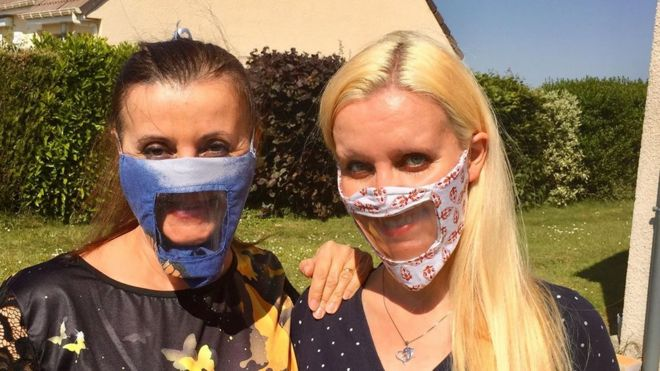 An example of a creative solution to see smiles through masks (via BBC)