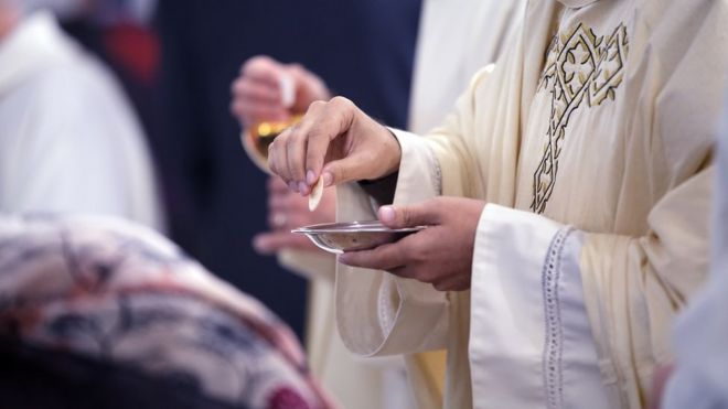 Image shows sacrament of communion
