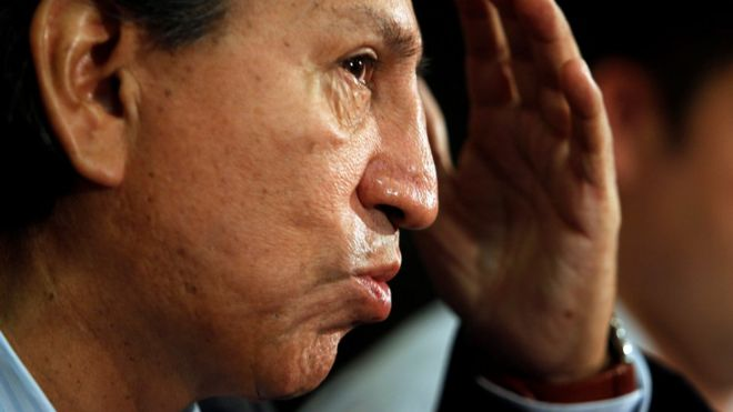 Former president Alejandro Toledo speaks to the media in Lima, January 27, 2011.