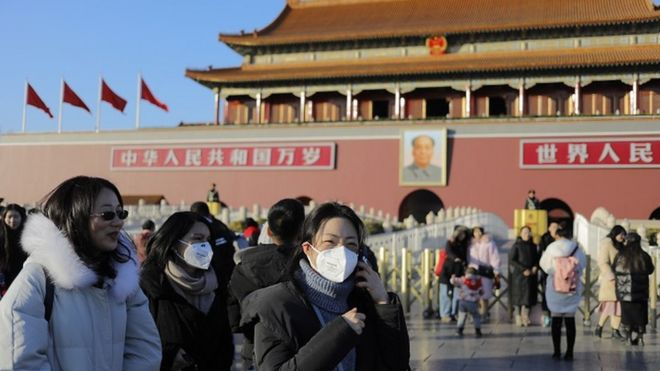 People wear masks in Beijing, China