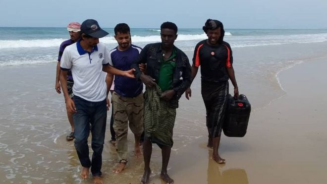 IOM Yemen officials assist a survivor from the capsized boat