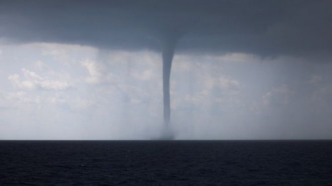 huge waterspout hits italy s south western city bbc news