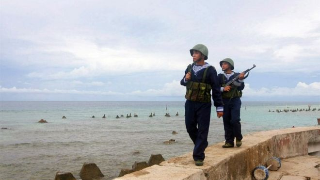 This picture taken by Vietnam News Agency and released on June 14, 2011 shows Vietnamese sailors patrolling on Phan Vinh Island in the Spratly archipelago