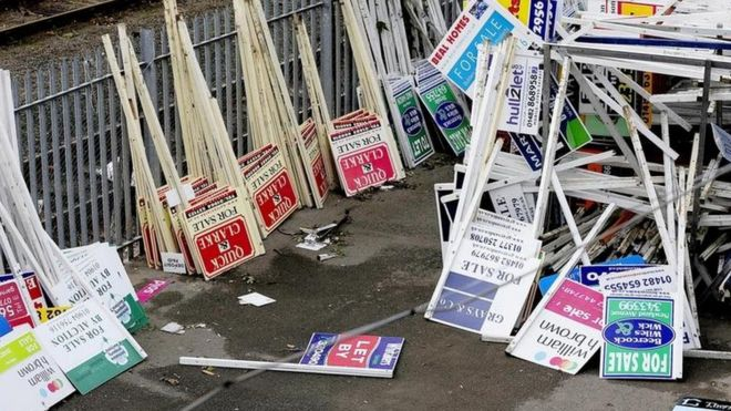 For sale signs on ground