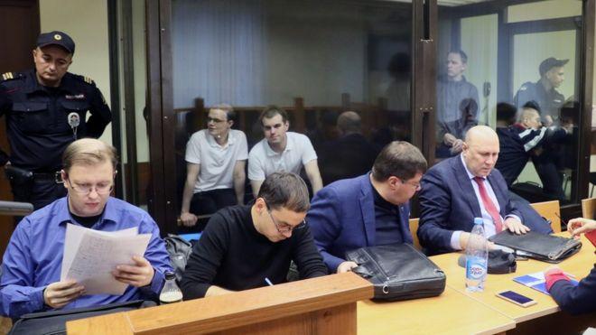 Vyacheslav Kryukov (far left) and Ruslan Kostylenkov (2nd left) in court