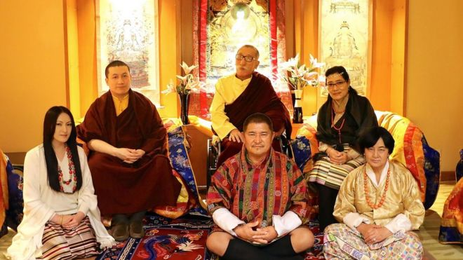 , shows The Karmapa Thaye Dorje (2L) and his parents Mipham Rinpoche (C/TOP), Dechen Wangmo Bottom (R/REAR) Rinchen Yangzom (L) and her parents Chencho (C/FRONT) and Kunzang (R) as they pose in New Delhi on March 25, 2017