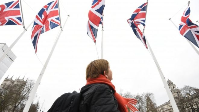 A member of the public views Union Jack flags in Parliament Square, London, ahead of the UK leaving the EU at 23:00 on Friday, 31 January