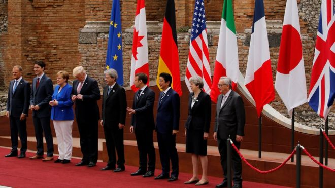 European Council President Donald Tusk, Canadian Prime Minister Justin Trudeau, German Chancellor Angela Merkel, US President Donald Trump, Italian Prime Minister Paolo Gentiloni, French President Emmanuel Macron, Japanese Prime Minister Shinzo Abe, Britain's Prime Minister Theresa May and European Commission President Jean-Claude Juncker pose for a family photo at the Greek Theatre during the G7 Summit in Taormina, Sicily,