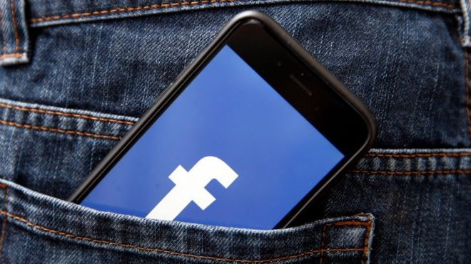 The Facebook symbol on a mobile phone
