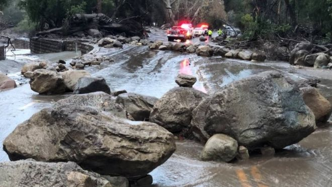 Boulders block a road after a mudslide in Montecito, California.