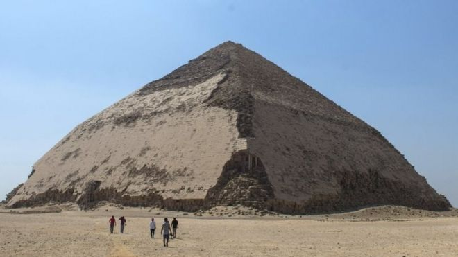 People walk in front of the Bent Pyramid. Photo: 13 July 2019