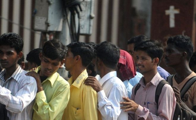 Indian youth queue at a jobs fair in Mumbai on October 12, 2011.
