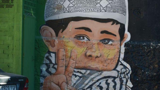 غرافيتي على أحد جدران مليلة