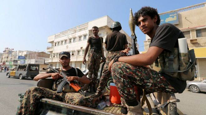 Houthi militants patrol a street in the port city of Hudaydah