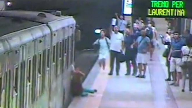 The woman is dragged along the platform of a Rome metro station