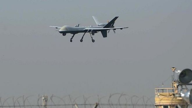 A US drone aircraft lands at Afghanistan's Jalalabad Airport where a US C-130 military