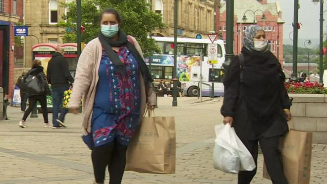 People in masks in Oldham
