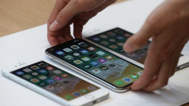 Men accused of $1m fake iPhone scam - BBC News