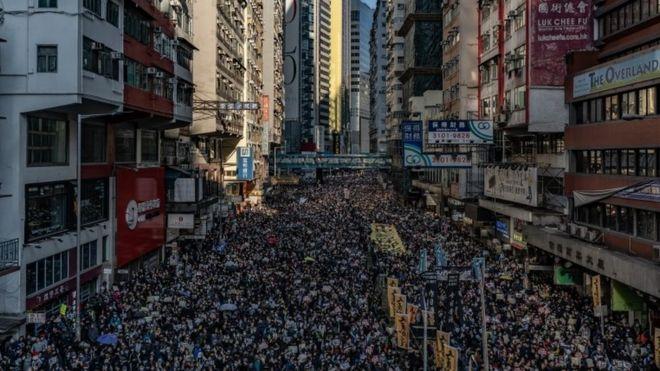 Tens of thousands march through Hong Kong