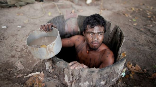 Paulo Paulino Guajajara draws water from a well at a loggers camp on Arariboia indigenous land near the city of Amarante, Maranhao state, Brazil.