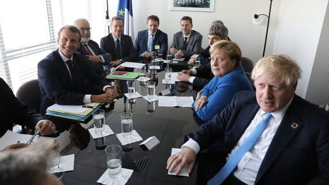 French President Emmanuel Macron (L) meets with German Chancellor Angela Merkel and British Prime Minister Boris Johnson (R) at the UN headquarters on Sept 23, 2019, in New York