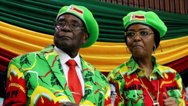 Robert Mugabe and Grace Mugabe in Zanu-PF outfits