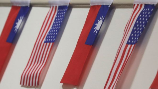 "The flags of Taiwan and USA are on display during the ceremonial opening of the ""Taiwan Council for US Affairs"" office in Taipei,"