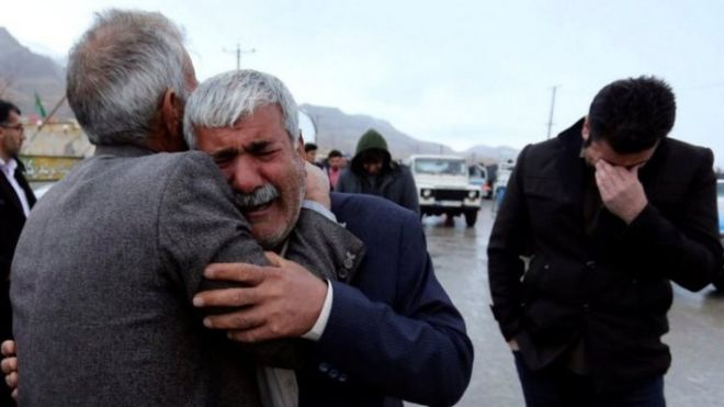 Relatives of passengers who are feared to have been killed in a plane crash react near the town of Semirom, Iran. Photo: 18 February 2018