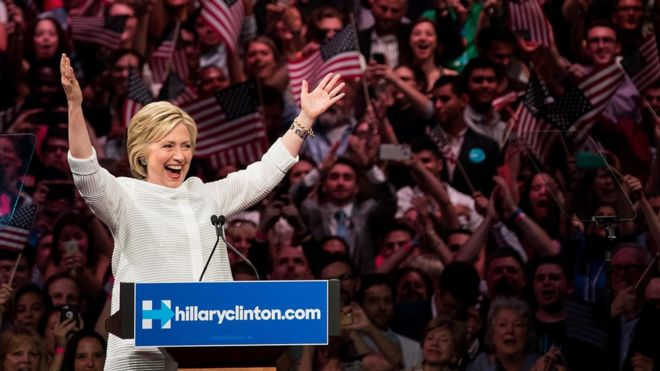 Hillary with her arms up high during a rally