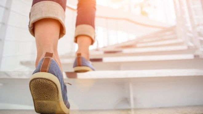 china employees fined for walking fewer than 180 000 steps bbc news