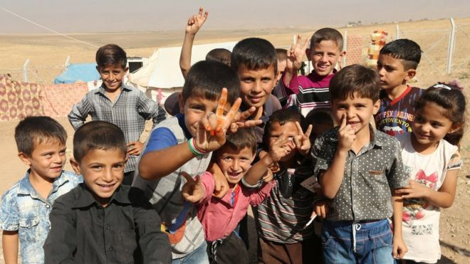 Displaced Iraqi children who fled Mosul pose for a photograph at a refugee camp in Duhok, Iraq