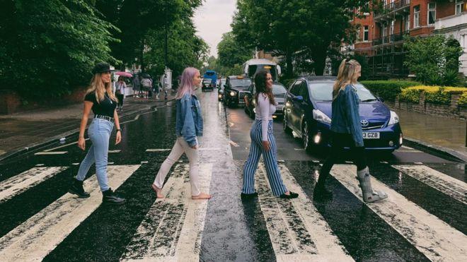 Jenna walks bare foot across Abbey road crossing.