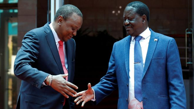 Kenya's President Uhuru Kenyatta (L) greets opposition leader Raila Odinga of the National Super Alliance (NASA) coalition after addressing a news conference at the Harambee house office in Nairobi, Kenya March 9, 2018