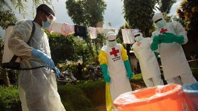 A Red Cross Safe and Dignified Burial team (SDB) respond to an Ebola alert in the DRC