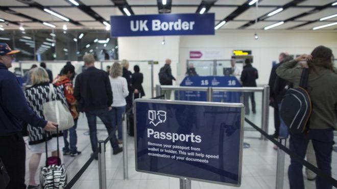 Border Force check passports at Gatwick Airport