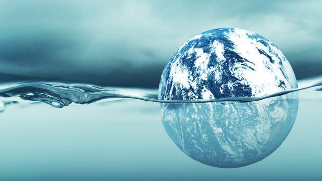 Illustración de un planeta parcialmente bajo agua